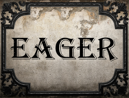 eager: eager word on concrette wall Stock Photo