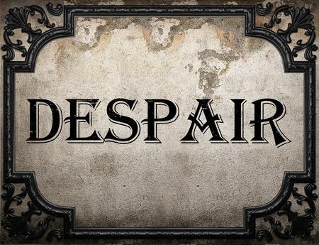 despair: despair word on concrette wall