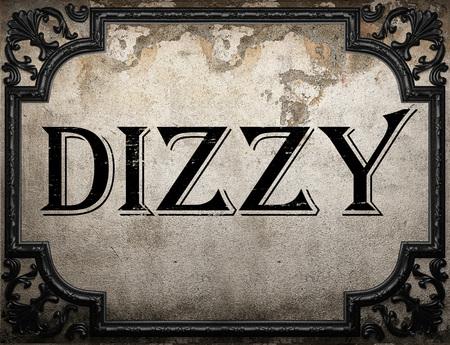 dizzy: dizzy word on concrette wall