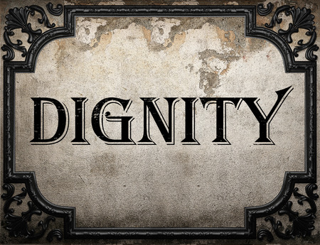 dignity: dignity word on concrette wall