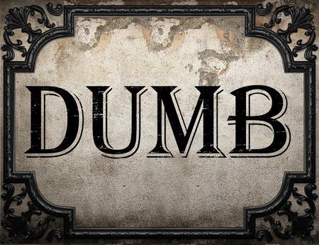 dumb: dumb word on concrette wall