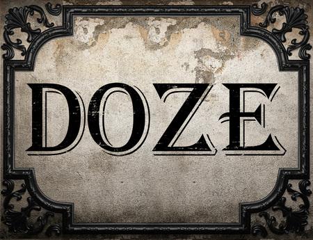 doze: doze word on concrette wall