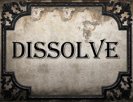 dissolve: dissolve word on concrette wall Stock Photo