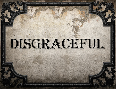disgraceful: disgraceful word on concrette wall