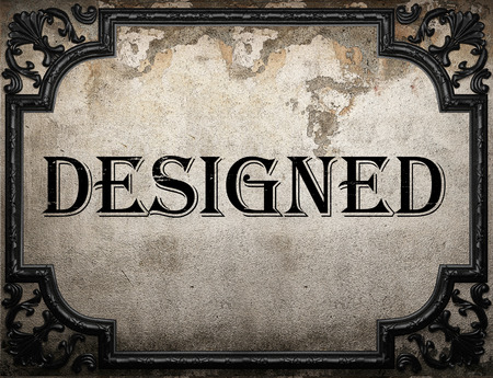 designed: designed word on concrette wall Stock Photo