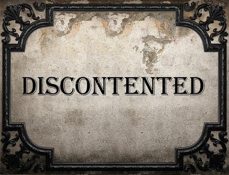 discontented: discontented word on concrette wall Stock Photo