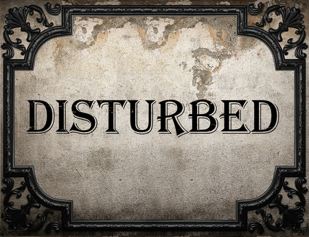 disturbed: disturbed word on concrette wall
