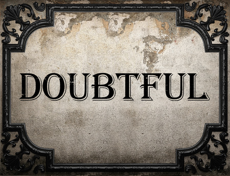doubtful: doubtful word on concrette wall