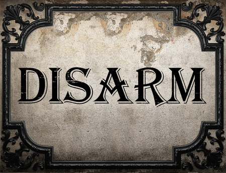 disarm: disarm word on concrette wall