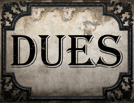 dues: dues word on concrette wall Stock Photo