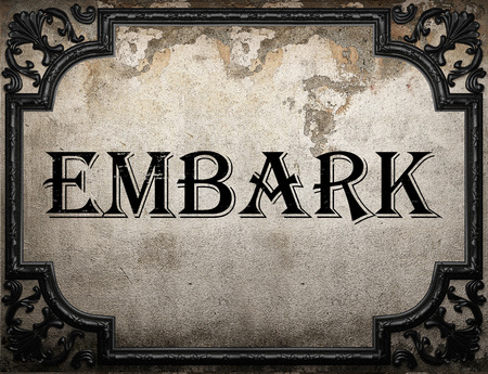 embark: embark word on concrette wall Stock Photo