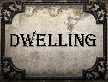 dwelling: dwelling word on concrette wall Stock Photo