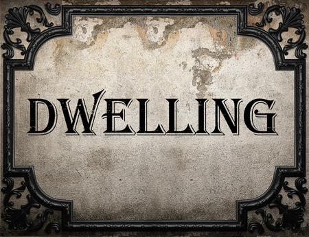 dwelling: dwelling word on concrette wall Stock Photo