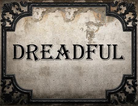 dreadful: dreadful word on concrette wall Stock Photo