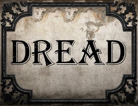 dread: dread word on concrette wall Stock Photo
