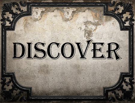 discover: discover word on concrette wall Stock Photo