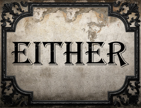 either: either word on concrette wall