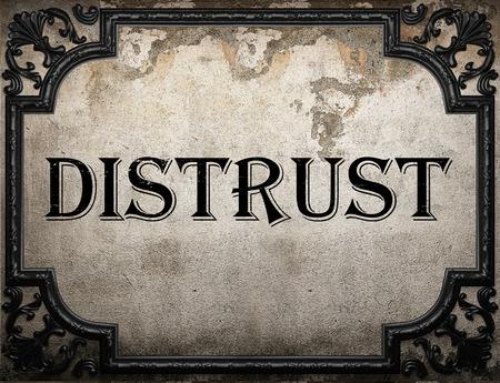 distrust: distrust word on concrette wall