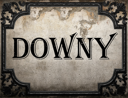 downy: downy word on concrette wall