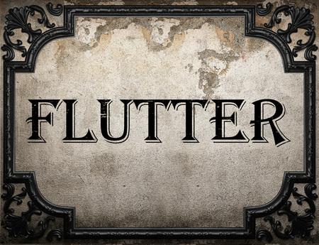 flutter: flutter word on concrette wall Stock Photo