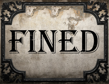 fined: fined word on concrette wall Stock Photo