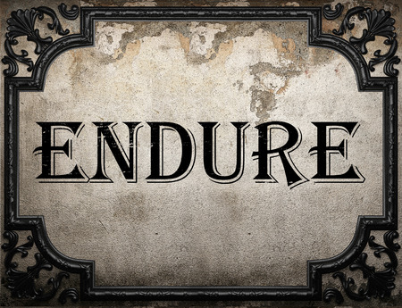 endure: endure word on concrette wall