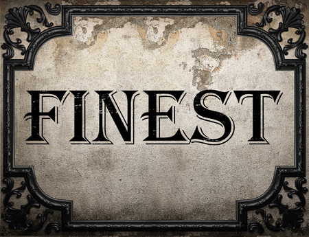 finest: finest word on concrette wall Stock Photo