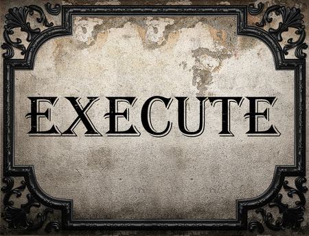 execute: execute word on concrette wall Stock Photo