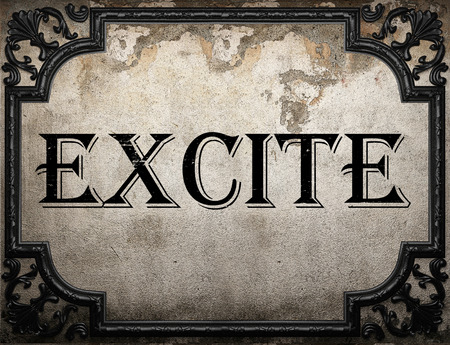 excite: excite word on concrette wall Stock Photo