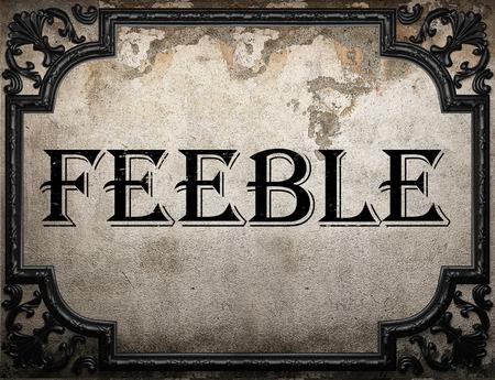 feeble: feeble word on concrette wall
