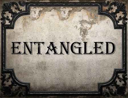 entangled: entangled word on concrette wall Stock Photo