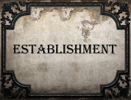 establishment: establishment word on concrette wall