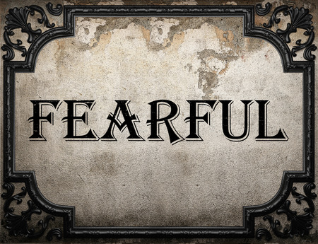 fearful: fearful word on concrette wall Stock Photo