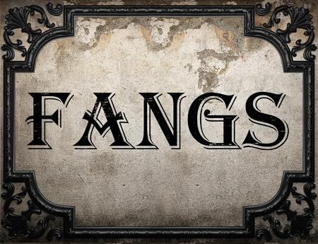 fangs: fangs word on concrette wall