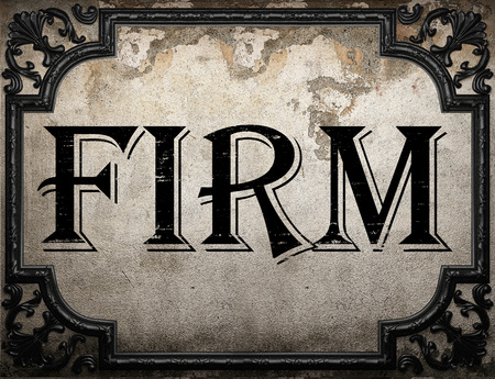 firm: firm word on concrette wall