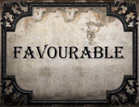 favourable: favourable word on concrette wall Stock Photo