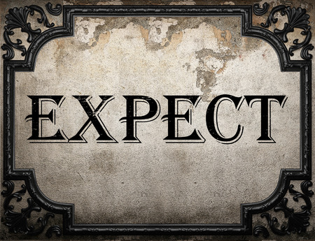 expect: expect word on concrette wall Stock Photo