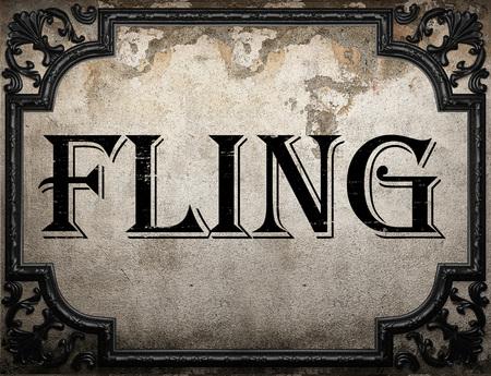 fling: fling word on concrette wall