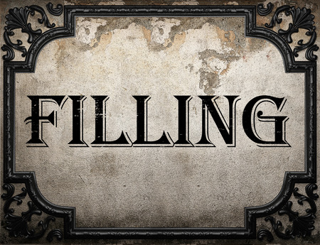 filling: filling word on concrette wall Stock Photo