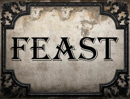 feast: feast word on concrette wall
