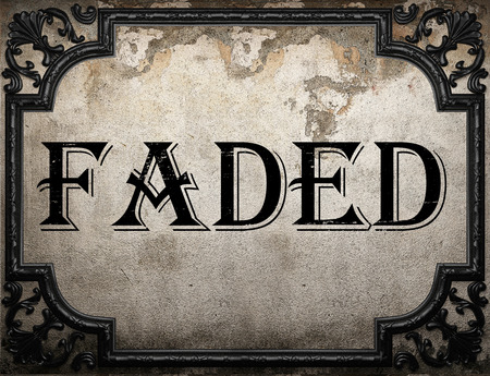 faded: faded word on concrette wall