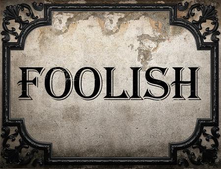 foolish: foolish word on concrette wall