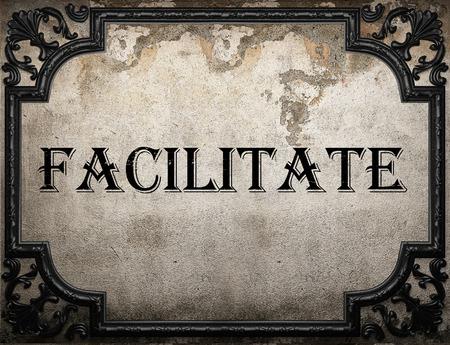 facilitate: facilitate word on concrette wall
