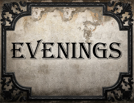 evenings: evenings word on concrette wall Stock Photo