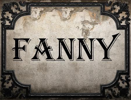 fanny: fanny word on concrette wall