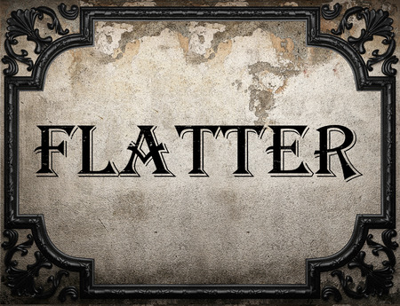 flatter: flatter word on concrette wall
