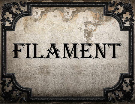 metal filament: filament word on concrette wall