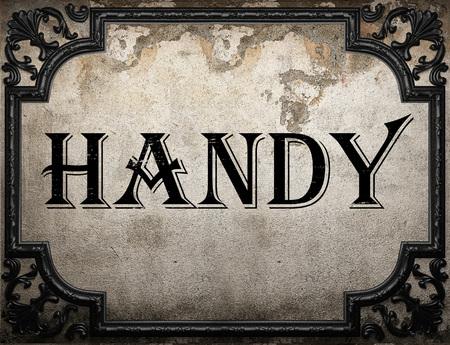 handy: handy word on concrette wall