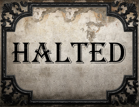 halted: halted word on concrette wall Stock Photo