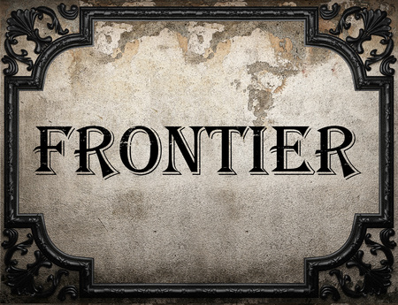 frontier: frontier word on concrette wall